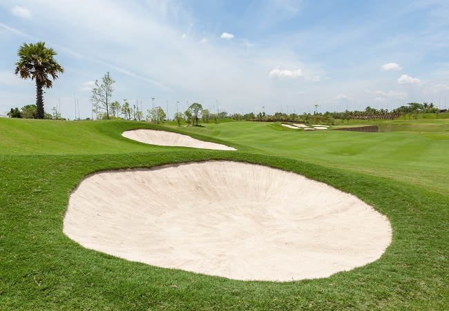 View of sand bunker on the beautiful golf course in Thailand